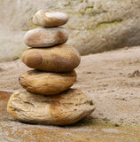 Close-up of stone stack on sandy beach Royalty Free Stock Photo