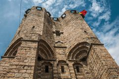 Close-up of stone watch-tower and flag in the Gravensteen Castle at Ghent. royalty free stock image