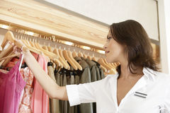 Close up of Store Assitant Working Stock Photography