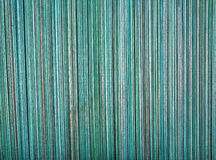 Close up straw cyan background. Texture of straw. Natural color cyan wooden background with bamboo and straw stock photo