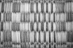Close up of a straw mat filtered grey tone. Stock Image