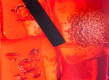 Close-up of straw in the red cocktail with ice cubes for background Royalty Free Stock Photo