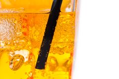 Close-up of straw in the yellow cocktail with ice cubes for background Royalty Free Stock Photos