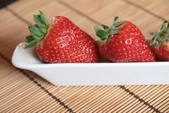 Close-up of strawberries in a white porcelain pot Royalty Free Stock Images
