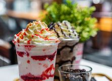 Close-up strawberry and chocolate frappe with whipped cream royalty free stock image