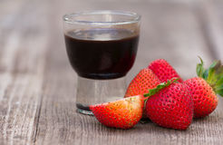 Close up of strawberry and chocolate syrup dessert. On old wood background Stock Photo