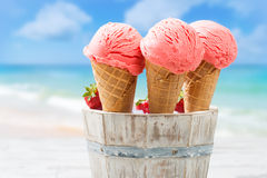 Close Up Strawberry Ice Creams. Close up of strawberry ice creams with beach blur background Royalty Free Stock Photography