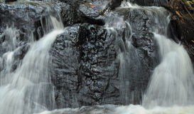 Close up of stream flow of waterfall royalty free stock photo