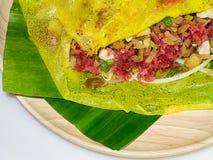 Street food name Banh xeo. Close up Street Food - Vietnamese Pancake Banh Xeo Royalty Free Stock Photography