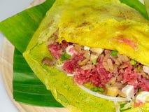 Street food name Banh xeo. Close up Street Food - Vietnamese Pancake Banh Xeo Stock Photos