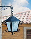 Close up of the street lamp hanging on the wall of an old buildi Royalty Free Stock Image