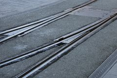 Close-up of street light tram tracks converge or diverge at an intersection. Up to you. royalty free stock photography