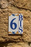 Close-up of street numbering made in ceramic in Châteauneuf-du-Pape. Stock Photography