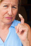 Close up stressed Woman in pain band aid finger Royalty Free Stock Photos