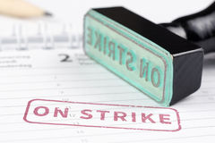 Close up of on strike stamp Royalty Free Stock Photo