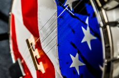 Banjo with American flag. Close up of strings and body of banjo decorated with American flag stock photography