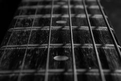 Guitar stings. Close up strings of old acoustic guitar. Black and white picture Royalty Free Stock Photo