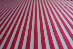 Closeup of striped fabric in pink and white. Close up of striped fabric in pink and white Royalty Free Stock Photos