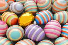 Close-Up of striped and golden easter eggs. Illustration for holiday. 3d render.  Royalty Free Stock Images