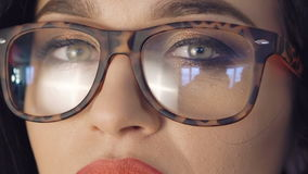 Close up strong look of pretty girl`s eyes in glasses stock video