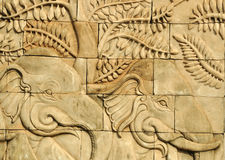 Close up stucco carved wall depicting elephants Royalty Free Stock Photography