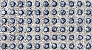 The close-up studded of tactile paving block (braille block). Royalty Free Stock Photography