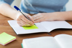 Close up of student with book and notebook at home Stock Images