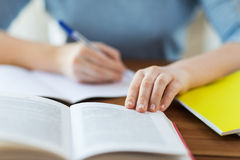 Close up of student with book and notebook at home Stock Photography