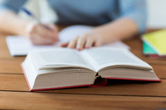 Close up of student with book and notebook at home royalty free stock photo