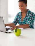 Close up of student girl with laptop and apple Royalty Free Stock Photography