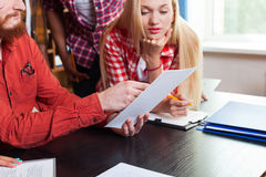 Close Up Student High School Group Looking At Paper Document With Professor Sitting At Desk, Young People Teacher. Discuss Communicate University Classroom Royalty Free Stock Photos
