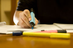 Close-up of a student using the marker pen Stock Images