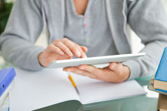 Close-up of a student using a touch pad Royalty Free Stock Images