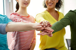 Close up of students or friends with hands on top Stock Images