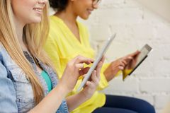 Close up of students with tablet pc at school Stock Photography
