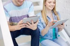 Close up of students with tablet pc at school Stock Photos