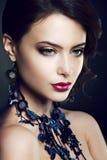 Close-up studio portrait of beautiful woman. Royalty Free Stock Image