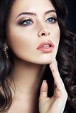 Close-up studio portrait of beautiful woman. Stock Images