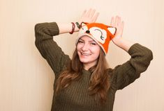 Close up studio portrait of cheerful hipster girl in funny fox h stock images
