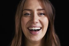 Close Up Studio Portrait Of Laughing Young Woman stock photos