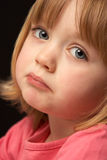 Close Up Studio Portrait Of Sad Young Girl Stock Photography