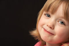 Close Up Studio Portrait Of Smiling Young Girl Royalty Free Stock Image