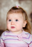 Close-up studio portrait of upset little girl with long blond hair Royalty Free Stock Photography