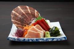 Close up studio shot of fresh sashimi combo. On a dining table stock photography