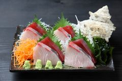 Fresh sashimi combo plate on a dining table. Close up studio shot of fresh sashimi combo plate on a dining table stock photo
