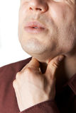 Close Up Studio Shot Of Man Suffering From Sore Throat Royalty Free Stock Image