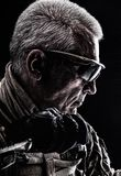 Special Forces Veteran. Close up studio shot of special forces white-haired veteran with knife. Sudden death killing concept Royalty Free Stock Image