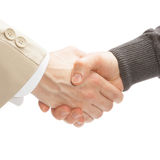 Close up studio shot of two men shaking hands Royalty Free Stock Photography
