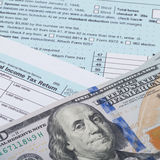 Close up studio shot of US 1040 Tax Form and dollars over it Royalty Free Stock Photo