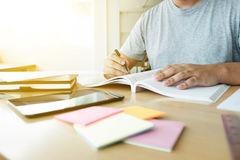 Close up of studying student hands writing in book during lectur Royalty Free Stock Photography